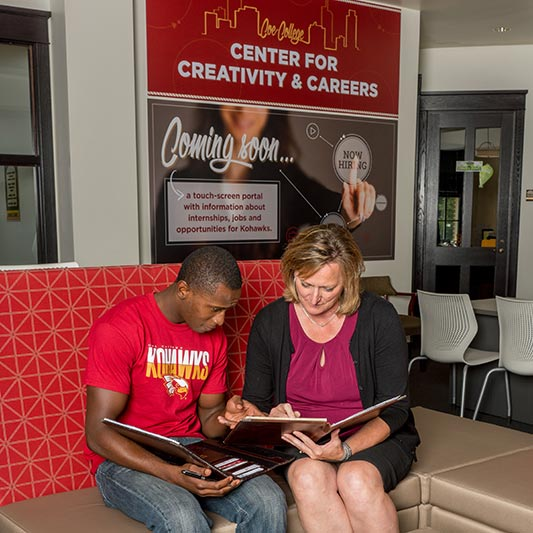 A student works with an advisor in the Center for Creativity and Careers