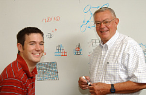 Professor Kent Herron working with a student
