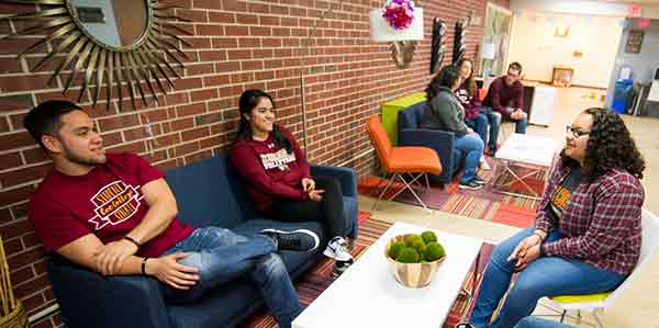 Several Coe students hanging out in the intercultural center