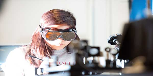 Student in a lab with safety goggles