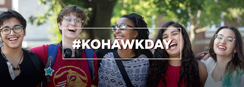 Photo of five laughing students outside with the text #KohawkDay