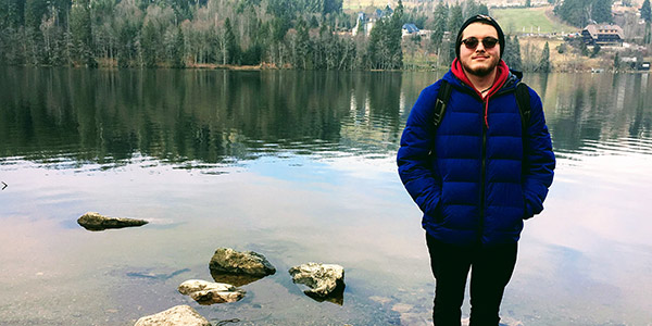 A student is pictured in the Black Forest while studying abroad in Germany.