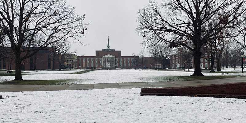 Snow covered campus with a view of Marquis Hall