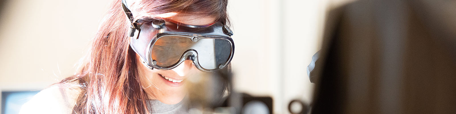 Coe science student with protective goggles