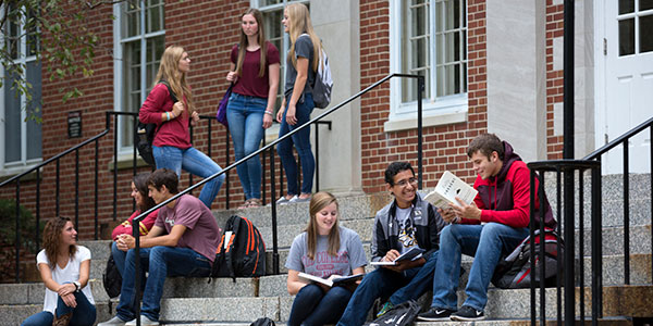 Students talking on the steps outside of Marquis Hall