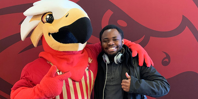 Obi Nwosu poses with Charlie Kohawk