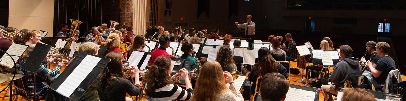 Concert Band rehearsal, conductor leading