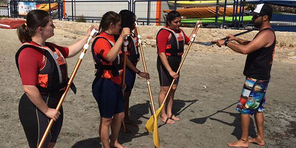 Students learning to paddleboard