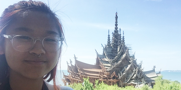 A student is pictured studying abroad in Thailand.