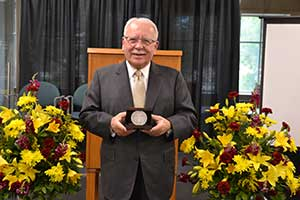 Dr. Bruce Spivey '56 recently was presented with Coe's highest honor — the Founders' Medal