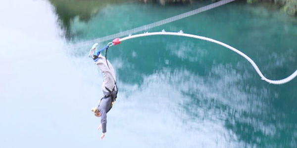 A student is pictured bungee jumping New Zealand.