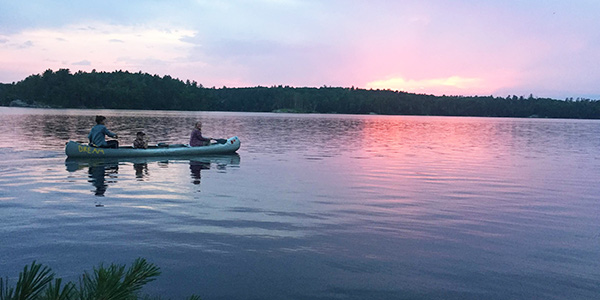 Students are pictured canoeing while taking a course at the Wilderness Field Station.